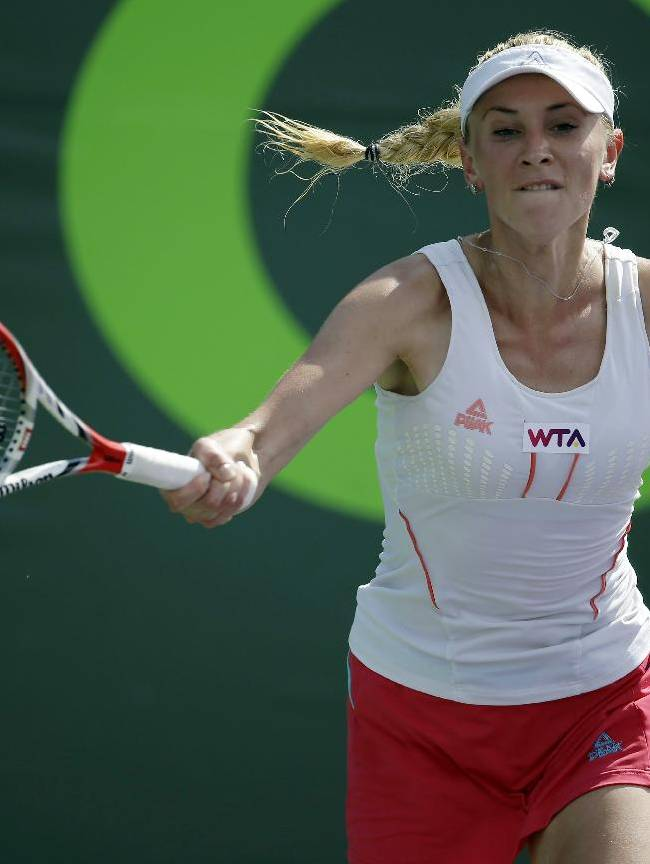 Olga Govortsova, of Belarus, returns the ball to Flavia Pennetta, of Italy, at the Sony Open tennis tournament, Thursday, March 20, 2014, in Key Biscayne, Fla. AP Photo/Lynne Sladky)