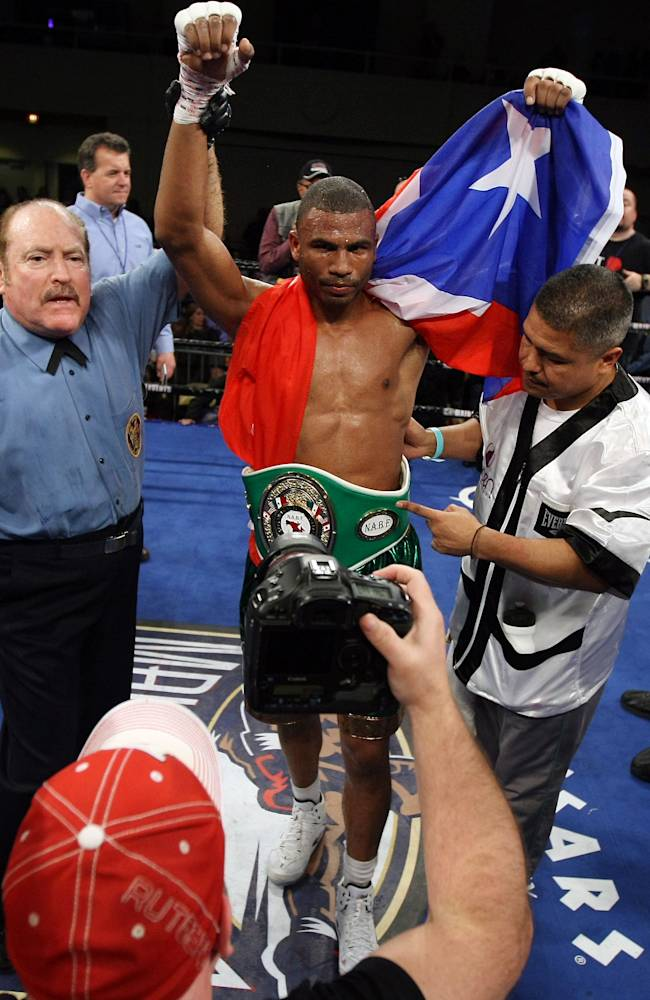 Thomas Dulorme of Puerto Rico celebrates after beating Karim Mayfield of San Francisco, by unanimous decision in ten rounds of a light welterweight boxing match in Atlantic City, N.J. on Saturday, March 29, 2014