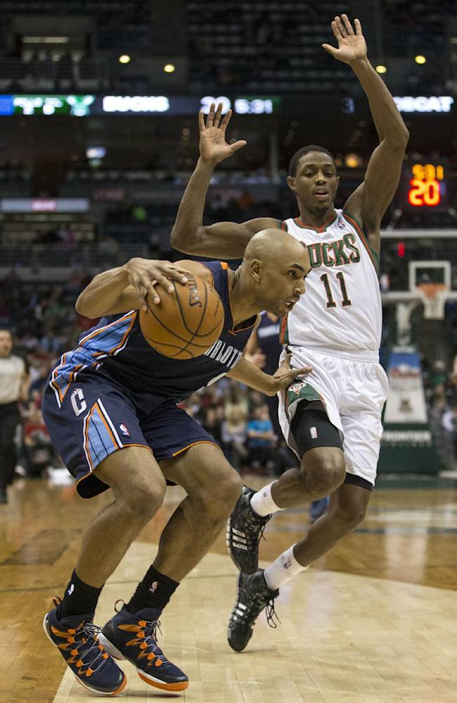 Milwaukee Bucks' Brandon Knight, right, is called for a foul while trying to defend against Charlotte Bobcats' Gerald Henderson during the first half of an NBA basketball game on Sunday, March 16, 2014, in Milwaukee