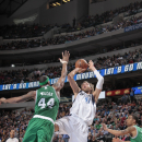 DALLAS, TX - MARCH 22: Dirk Nowitzki #41 of the Dallas Mavericks shoots against Chris Wilcox #44 of the Boston Celtics on March 22, 2013 at the American Airlines Center in Dallas, Texas. (Photo by Danny Bollinger/NBAE via Getty Images)