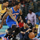Denver Nuggets forward Wilson Chandler, left, and New York Knicks guard J.R. Smith pursue a loose ball in the third quarter of the Nuggets' 97-95 victory in an NBA basketball game in Denver on Friday, Nov. 29, 2013 The Associated Press