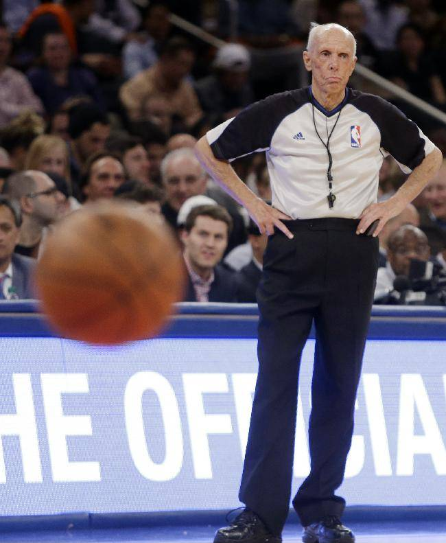 FILE - In this April 2, 2014, file photo, official Dick Bavetta watches during a free throw in the second half of an NBA basketball game between the New York Knicks and the Brooklyn Nets in New York. Bavetta, 74, tells The Associated Press that it is the right time to leave the game after a 39-year career. (AP Photo/Frank Franklin II, File)