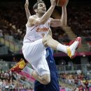 Spain's Jose Calderon (8) leaps under the basket to score against Great Britain during a preliminary men's basketball game at the 2012 Summer Olympics, Thursday, Aug. 2, 2012, in London. (AP Photo/Eric Gay)
