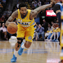 Denver Nuggets forward Wilson Chandler (21) drives past Dallas Mavericks guard Vince Carter in the third quarter of an NBA game in Denver on Wednesday, March 5, 2014. Chandler had 21 points in Denver's 115-110 victory The Associated Press