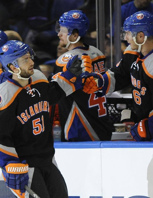 New York Islanders' Frans Nielsen (51) celebrates his third-period goal against the Carolina Hurricanes in an NHL hockey game, Saturday, Oct. 19, 2013, in Uniondale, N.Y. The Hurricanes won 4-3