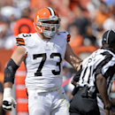 In this Sunday, Sept. 14, 2014 file photo, Cleveland Browns offensive tackle Joe Thomas (73) talks to umpire Roy Ellison (81) after Thomas was called for holding in the third quarter of an NFL football game against the New Orleans Saints in Cleveland. Cle