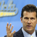FILE - In this April 2, 2013 file photo, Steve Alford, UCLA's new men's basketball coach, gestures during a news conference at the Pauley Pavilion in Los Angeles. A University of New Mexico official says former Lobos basketball coach Alford is willing to pay a $200,000 buyout for leaving the Albuquerque school to take a job at UCLA but he won't pay the $1 million payment that New Mexico wants. (AP Photo/Damian Dovarganes, File)