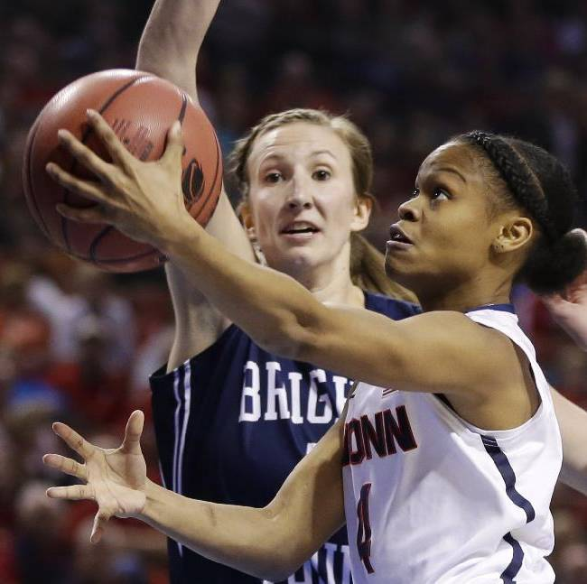 Connecticut's Moriah Jefferson (4) goes for a layup against BYU's Jennifer Hamson, rear, during the first half of a regional semifinal in the NCAA college basketball tournament in Lincoln, Neb., Saturday, March 29, 2014