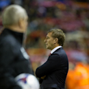 Liverpool's manager Brendan Rodgers takes to the touchline before his team's English League Cup soccer match between Liverpool and Swansea at Anfield Stadium, Liverpool, England, Tuesday Oct. 28, 2014