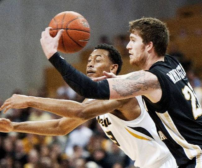 Missouri's Johnathan Williams III, left, and Western Michigan's Shayne Whittington, right, battle for a rebound during the first half of an NCAA college basketball game Sunday, Dec. 15, 2013, in Columbia, Mo