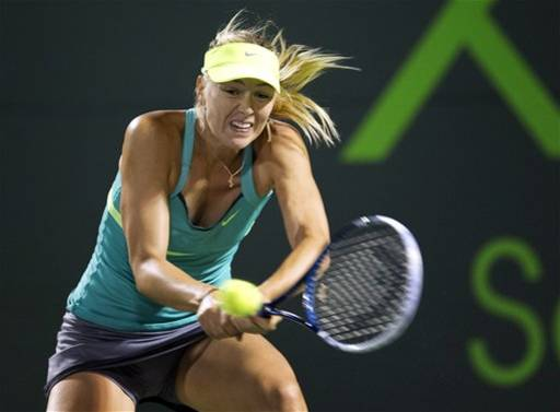 Maria Sharapova, of Russia, returns the ball to Klara Zakopalova, of the Czech Republic, during the Sony Open Tennis tournament in Key Biscayne, Fla., Monday, March 25, 2013