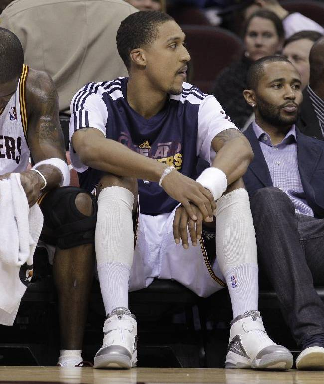 In this Jan. 28, 2011, photo, Cleveland Cavaliers' Antawn Jamison (4), Jamario Moon, and injured guard Mo Williams sit on the bench in the waning moments of the team's 117-103 loss to the Denver Nuggets in an NBA basketball game in Cleveland. The Philadelphia 76ers are one loss away from tying the NBA record of 26 straight losses, set by the 2010-11 Cavaliers
