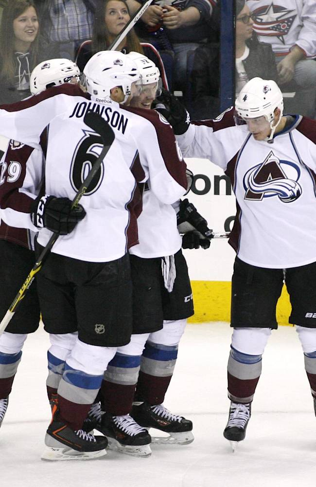 Colorado Avalanche's Gabriel Landeskog (92), center, celebrates with teammates after scoring the winning goal against Columbus Blue Jackets in overtime of an NHL hockey game, Tuesday, April 1, 2014, in Columbus, Ohio