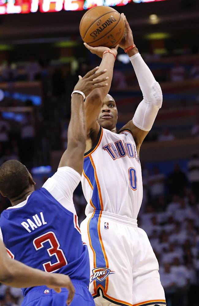 Oklahoma City Thunder guard Russell Westbrook (0) shoots over Los Angeles Clippers guard Chris Paul (3) in the second half of Game 5 of the Western Conference semifinal NBA basketball playoff series in Oklahoma City, Tuesday, May 13, 2014. Oklahoma City won 105-104. (AP Photo)