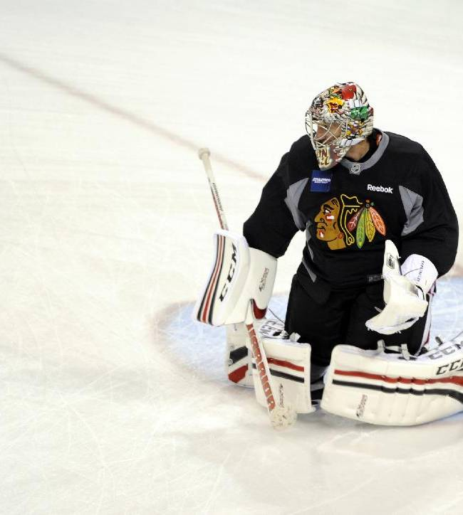 Chicago Blackhawks' goaltender Nikolai Khabibulin, of Russia, makes a save during a drill at NHL hockey training camp on the campus of the University of Notre Dame in South Bend, Ind., Thursday, Sept. 12, 2013