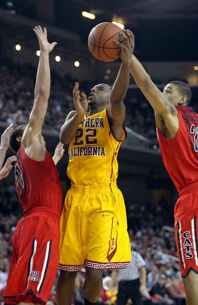 Southern California guard Byron Wesley, center, puts up a shot as Arizona forward Aaron Gordon, left, and forward Brandon Ashley defend during the second half of an NCAA college basketball game, Sunday, Jan. 12, 2014, in Los Angeles