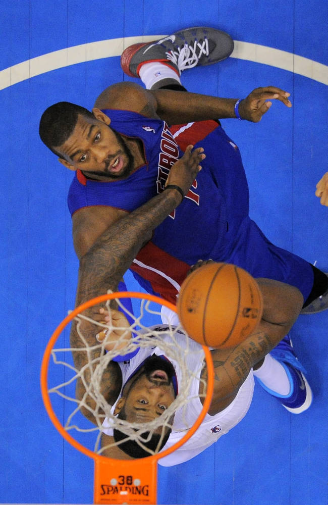 Detroit Pistons forward Greg Monroe, top, puts up a shot as Los Angeles Clippers center DeAndre Jordan defends during the second half of an NBA basketball game, Saturday, March 22, 2014, in Los Angeles. The Clippers won 112-103