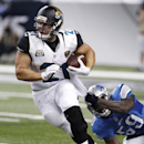 Jacksonville Jaguars running back Toby Gerhart (21) is brought down from behind by Detroit Lions linebacker Tahir Whitehead (59) in the second half of a preseason NFL football game at Ford Field in Detroit, Friday, Aug. 22, 2014 The Associated Press
