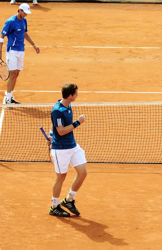 Britain's Andy Murray right, celebrates after winning a point to Italy's Andreas Seppi during a Davis Cup World Group quarterfinal match in Naples, Italy, Saturday, April 5, 2014.  Andy Murray completed a straight sets victory over Andreas Seppi as Britain leveled the Davis Cup quarterfinal against Italy 1-1 on Saturday. Murray won 6-4, 7-5, 6-3