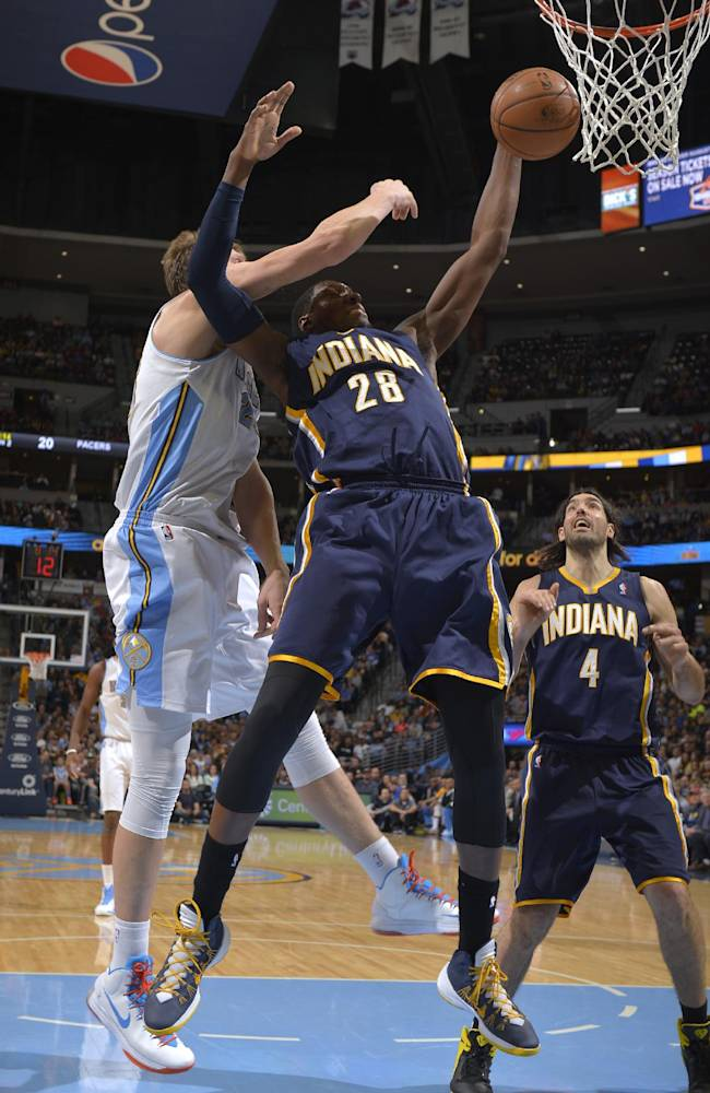 Indiana Pacers center Ian Mahinmi (28) from France grabs a rebound from Denver Nuggets center Timofey Mozgov (25) from Russia during the second quarter of an NBA basketball game Saturday, Jan. 25, 2014, in Denver