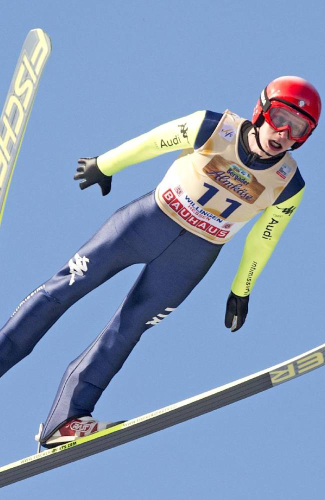 Sebastian Colloredo of Italy soars through the air during the FIS World Cup ski jumping in Willingen, Germany, Sunday, Feb. 2, 2014