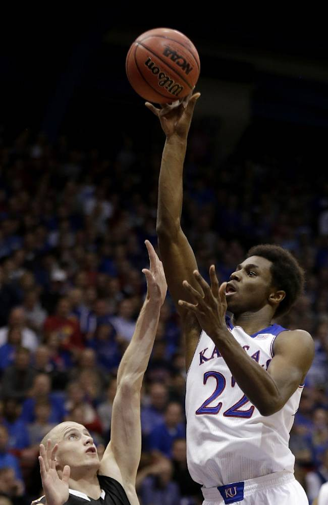 Kansas' Andrew Wiggins (22) gets past Fort Hays State's Tomislav Gabric to put up a shot during the first half of an exhibition NCAA college basketball game Tuesday, Nov. 5, 2013, in Lawrence, Kan