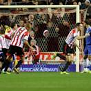 Sunderland's captain John O'Shea, center, celebrates his goal during their English Premier League soccer match against Chelsea at the Stadium of Light, Sunderland, England, Wednesday, Dec. 4, 2013. (AP Photo/Scott Heppell)