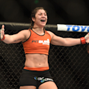 August 30, 2014; Sacramento, CA, USA; Bethe Correia (red gloves) reacts after defeating Shayna Baszler (blue gloves) during the women s bantamweight bout of UFC 177 at Sleep Train Arena. (Kyle Terada-USA TODAY Sports)