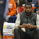 Syracuse's James Southerland, who did not play due to academic issues, sits on the bench during the first half of an NCAA college basketball game against Villanova in Syracuse, N.Y., Saturday, Jan. 12, 2013. (AP Photo/Kevin Rivoli)