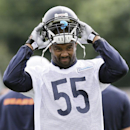 Chicago Bears linebacker Lance Briggs (55) puts on his helmet during NFL football training camp at Olivet Nazarene University on Friday, July 25, 2014., in Bourbonnais, Ill The Associated Press