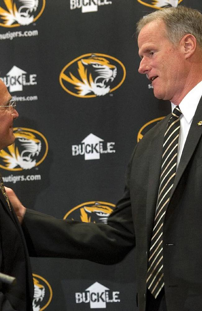 Missouri athletic director Mike Alden, left, greets new Missouri men's basketball coach Kim Anderson after Anderson was introduced at an NCAA college basketball news conference in the Reynolds Alumni Center on Tuesday, April 29, 2014, in Columbia, Mo