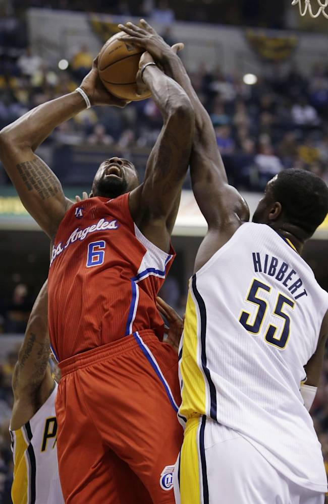 Los Angeles Clippers center DeAndre Jordan (6) gets his shot blocked by Indiana Pacers center Roy Hibbert (55) during the first half of an NBA basketball game in Indianapolis, Saturday, Jan. 18, 2014