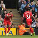 Liverpool's Luis Suarez, left, celebrates scoring his side's second goal with Raheem Sterling who scored their first, during their English Premier League match against Norwich City at Carrow Road, Norwich, eastern England, Sunday April 20, 2014