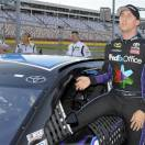 Denny Hamlin climbs from his car after qualifying for Sunday's NASCAR Sprint Cup series Coca-Cola 600 auto race at Charlotte Motor Speedway in Concord, N.C., Thursday, May 23, 2013. Hamlin won the pole position for the race. (AP Photo/Mike McCarn)