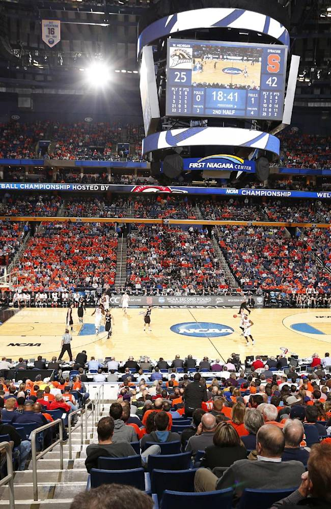 Fans watch during the second half of a second-round game between Syracuse and Western Michigan in the NCAA college basketball tournament in Buffalo, N.Y., Thursday, March 20, 2014