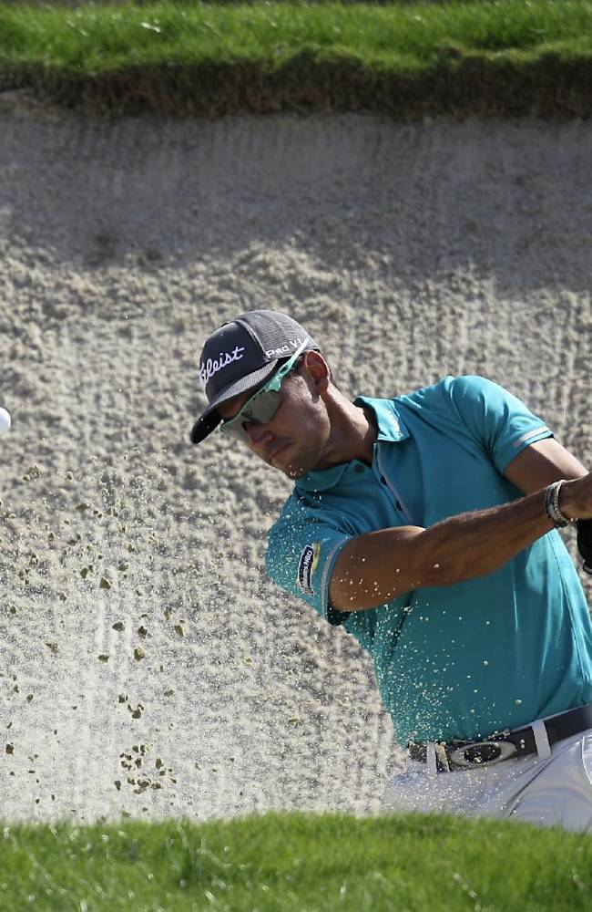 Spain's Rafa Cabrera-Bello plays a bunker shot on the 2nd hole during the 2nd round of DP World Golf Championship in Dubai, United Arab Emirates, Friday, Nov. 15, 2013