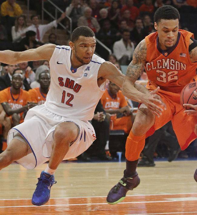 SMU's Nick Russell (12) and Clemson's K.J. McDaniels (32) fight for control of the ball during the first half of an NCAA college basketball game in the semifinals of the NIT Tuesday, April 1, 2014, in New York