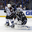 Tampa Bay Lightning goalie Ben Bishop (30) makes a save in front of Colorado Avalanche's Cody McLeod as Lightning's Andrej Sustr, of the Czech Republic, defends during the third period of an NHL hockey game Saturday, Jan. 17, 2015, in Tampa, Fla. The Ligh