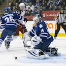 Toronto Maple Leafs goalie James Reimer, right, makes a save as Leafs' Carl Gunnarsson, left, covers Columbus Blue Jackets' Ryan Johansen during the first period of an NHL hockey game in Toronto on Monday, March 3, 2014 The Associated Press