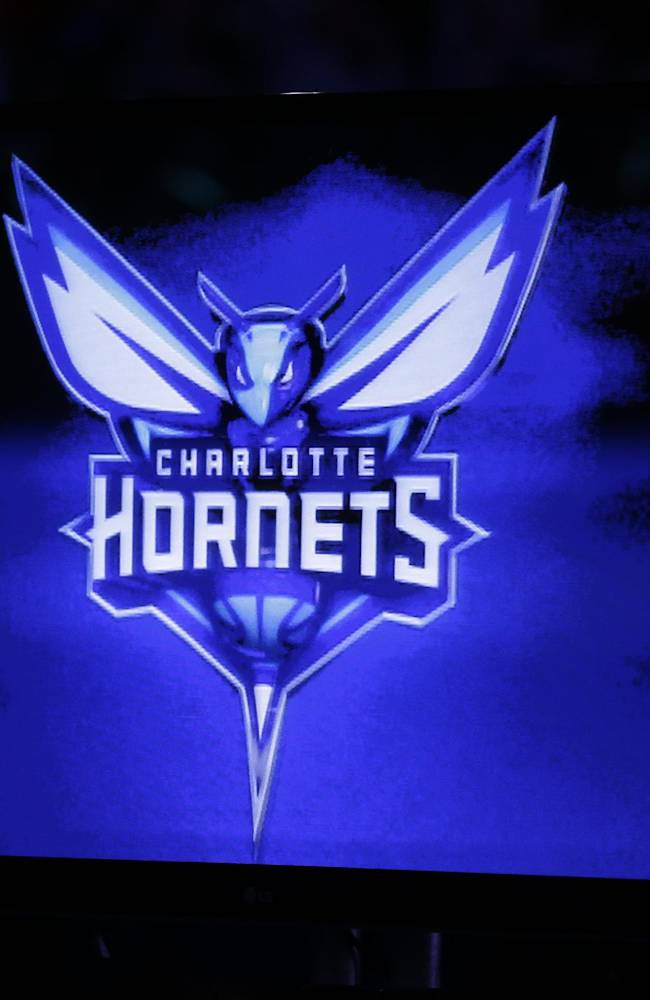 The new logo of the Charlotte Hornets is displayed on a video monitor during a halftime ceremony of an NBA basketball game between the Charlotte Bobcats and the Utah Jazz in Charlotte, N.C., Saturday, Dec. 21, 2013. The Bobcats will change their name to the Hornets next season