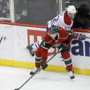 Minnesota Wild defenseman Christian Folin (5) and Montreal Canadiens right wing Dale Weise (22) battle for the puck during the first period an NHL hockey game in St. Paul, Minn., Wednesday, Dec. 3, 2014 The Associated Press