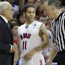 FILE - In this file photo made Saturday, Feb. 8, 2014, SMU guard Nic Moore (11) smiles as head coach Larry Brown listens to the referee during the second half of an NCAA college basketball game against Cincinnati in Dallas. For all the strides SMU has made in two seasons under Hall of Fame coach Larry Brown, the Mustangs' two-decades-plus NCAA tournament drought is still intact. (AP Photo/LM Otero, File)