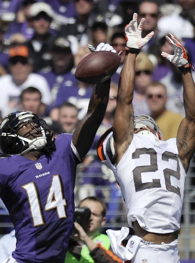 Baltimore Ravens wide receiver Marlon Brown (14) cannot hang on to a pass under pressure from Cleveland Browns cornerback Buster Skrine (22) during the first half of a NFL football game in Baltimore, Md., Sunday, Sept. 15, 2013