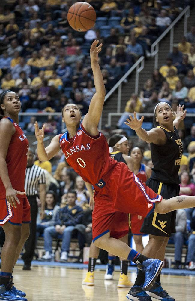 Kansas' Asia Boyd (0) drives to the basket during the first half of an NCAA college basketball game against West Virginia, Tuesday, March 4, 2014, in Morgantown, W.Va