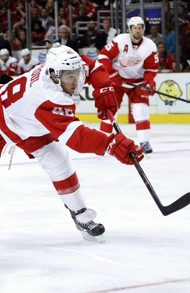 Detroit Red Wings defenseman Ryan Sproul takes a shot on goal during the first period of an NHL preseason hockey game against the Chicago Blackhawks, Tuesday, Sept. 17, 2013, in Chicago