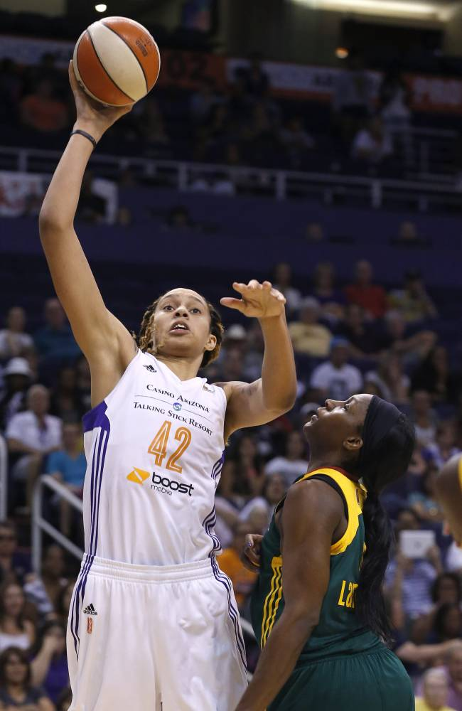 Phoenix Mercury's Brittney Griner (42) gets a shot off over Seattle Storm's Crystal Langhorne, right, during the second half of a WNBA basketball game on Tuesday, June 3, 2014, in Phoenix.  The Mercury defeated the Storm 87-72