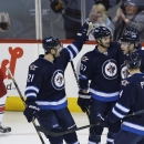 Lowry scores first goal to lift Jets over Canes The Associated Press