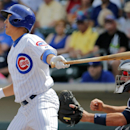 Chicago Cubs' Darwin Barney follows through on a base hit against the Seattle Mariners during the first inning of a spring training baseball game, Thursday, March 20, 2014, in Mesa, Ariz The Associated Press