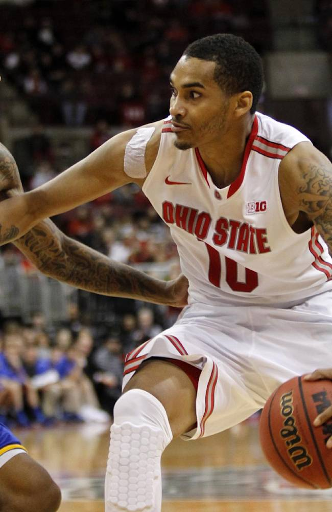 Ohio State's LaQuinton Ross, right, tries to get around Delaware's Davon Usher  during the second half of an NCAA college basketball game in Columbus, Ohio, Wednesday, Dec. 18, 2013. Ohio State won 76-64. ( AP Photo/Paul Vernon)