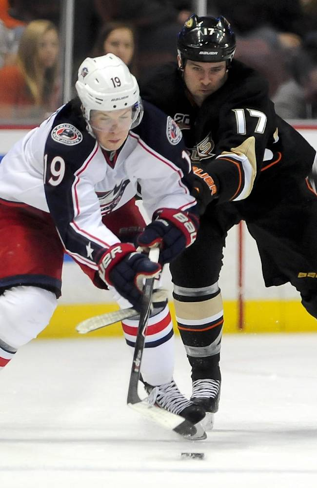 Columbus Blue Jackets center Ryan Johansen (19) and Anaheim Ducks left wing Dustin Penner (17) fight for possession during the second period of an NHL hockey game, Monday, Feb. 3, 2014, in Anaheim, Calif